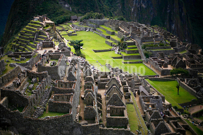 People tour the ruins of the Machu Picchu near Aguas Calientes, Peru, on May 18, 2008. Machu Picchu, often referred to as the ?Lost City of the Incas,? is a pre-Colombian Inca site situated on a mountain ridge above the Urubamba Valley. Visits to Peru?s top tourist destination have more than doubled in the last decade to 800,000 people.