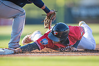 Wichita Wind Surge short stop Roy Morales (25) dives back to first base against the Northwest Arkansas Naturals at Riverfront Stadium on July 9, 2021 in Wichita, Kansas. (William Purnell/Four Seam Images)