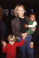 LOS ANGELES, CA - FEBRUARY 4: Mia Farrow with Ronan Farrow and Isaiah Justus Farrow on February 4, 1993 at the Los Angeles International Airport in Los Angeles, California.  Credit: Ralph Dominguez/MediaPunch