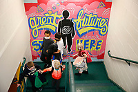 Students make their way to the gymnasium from the classroom at the Boys and Girls Club of Western Pennsylvania in the Lawrenceville neighborhood on Friday February 19, 2021 in Pittsburgh, Pennsylvania. (Photo by Jared Wickerham/Pittsburgh City Paper)