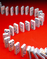 DOMINO EFFECT: 2 of 2<br /> (Variations Available)<br /> Falling In Succession In S-Curve Pattern<br /> A cumulative effect produced when one event, knocking over the first domino, sets off a chain of similar events.