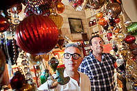 Pierre (left) and Laurent (right), co-owners of L'Heure Bleue, pose for the photographer in the salon of their tearoom, Montpellier, France, 13 July 2012. L'Heure Bleue is a tearoom / restaurant / antiques shop and new & second-hand clothing and accessory boutique all rolled into one.