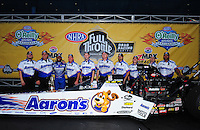 Sept. 18, 2011; Concord, NC, USA: NHRA top fuel dragster driver Antron Brown celebrates with his crew after winning the O'Reilly Auto Parts Nationals at zMax Dragway. Mandatory Credit: Mark J. Rebilas-