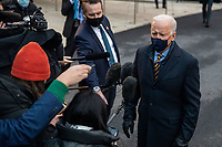 US President Joe Biden responds to a question from the news media as he walks to Marine One on the South Lawn of the White House in Washington, DC, USA, 16 February 2021. This evening President Biden is traveling to Minneapolis to participate in a town hall meeting where he will take questions on the pandemic and the economy.<br /> CAP/MPI/RS<br /> ©RS/MPI/Capital Pictures