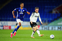 Max Bird of Derby County under pressure from Robert Glatzel of Cardiff City during the Sky Bet Championship match between Cardiff City and Derby County at the Cardiff City Stadium in Swansea, Wales, UK. Tuesday 14 July 2020