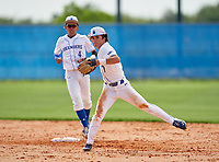 IMG Academy Ascenders Navy second baseman Owen Cravens (7) throws to first base as shortstop Fukuo Saso (4) looks on during a game against Victory Charter School on April 1, 2021 at IMG Academy in Bradenton, Florida.  (Mike Janes/Four Seam Images)