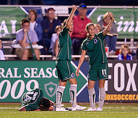 St. Louis Athletica forward Kerri Hanks (2) and forward Angie Woznuk (11) call for the medical staff as forward Melissa Tancredi (14) writhes in pain during a WPS match at Korte Stadium, in St. Louis, MO, May 9 2009. St. Louis Athletica won the match 1-0.