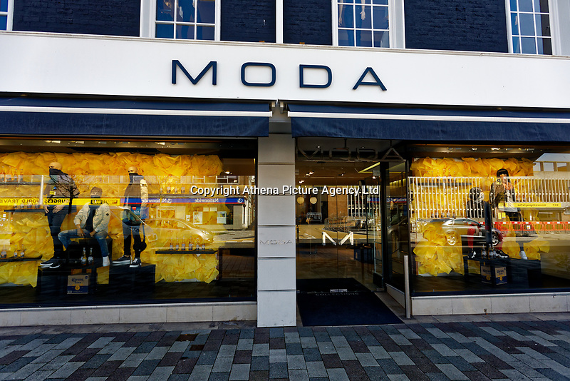 Pictured: The Corona beer based shop front of Moda, Swansea, Wales, UK. Monday 23 March 2020<br /> Re: The owner of Moda, a clothes shop on the Kingsway, in the city centre of Swansea, has been criticised for being insensitive after he decorated his shop window in Corona beer bottles and crates, and using scarves as face masks on the manequins.