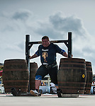 HAINAN ISLAND, CHINA - AUGUST 23:  Zydrunas Savickas of Lithuania competes at the Super Yoke event during the World's Strongest Man competition at Serenity Marina on August 23, 2013 in Hainan Island, China.  Photo by Victor Fraile