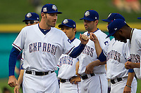 Round Rock Express pitcher Aaron Poreda #41 is greeted by his teammates before the Pacific Coast League baseball game against the Oklahoma City Redhawks on April 3, 2014 at the Dell Diamond in Round Rock, Texas. The Redhawks defeated the Express 7-6 in the season opener for both teams. (Andrew Woolley/Four Seam Images)