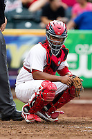Audry Perez (10) of the Springfield Cardinals looks like the pitch sign during a game against the Northwest Arkansas Naturals at Hammons Field on July 31, 2011 in Springfield, Missouri. Northwest Arkansas defeated Springfield 9-1. (David Welker / Four Seam Images)