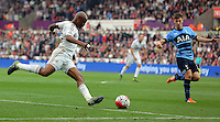 (L-R) Andre Ayew of Swansea crosses the ball over Ben Davies of Tottenham Hotspur during the Barclays Premier League match between Swansea City and Tottenham Hotspur played at The Liberty Stadium, Swansea on October 4th 2015