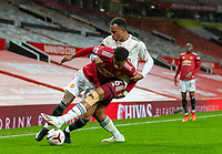 1st November 2020, Old Trafford, Manchester, England;  Arsenals Gabriel Magalhaes tackles Manchester Uniteds Marcus Rashford during the English Premier League match between Manchester United FC and Arsenal FC at Old Trafford