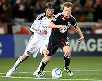 Dax McCarty (10) of D.C. United runs from David Beckham (23) of the Los Angeles Galaxy during an MLS match at RFK Stadium, on April 9 2011, in Washington D.C.The game ended in a 1-1 tie.