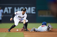 Charlotte Knights shortstop Eddy Alvarez (10) waits for the throw as Tim Lopes (5) of the Buffalo Bison steals second base at BB&T BallPark on August 14, 2018 in Charlotte, North Carolina. The Bison defeated the Knights 14-5.  (Brian Westerholt/Four Seam Images)