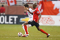 7 June 2011: USA Men's National Team midfielder Sacha Kljestan (16) and Canada midfielder Atiba Hutchinson (13) during the CONCACAF soccer match between USA and Canada at Ford Field Detroit, Michigan. USA won 2-0.