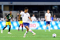 DALLAS, TX - JULY 25: Miles Robinson #12 of the United States passes the ball to a teammate during a game between Jamaica and USMNT at AT&T Stadium on July 25, 2021 in Dallas, Texas.