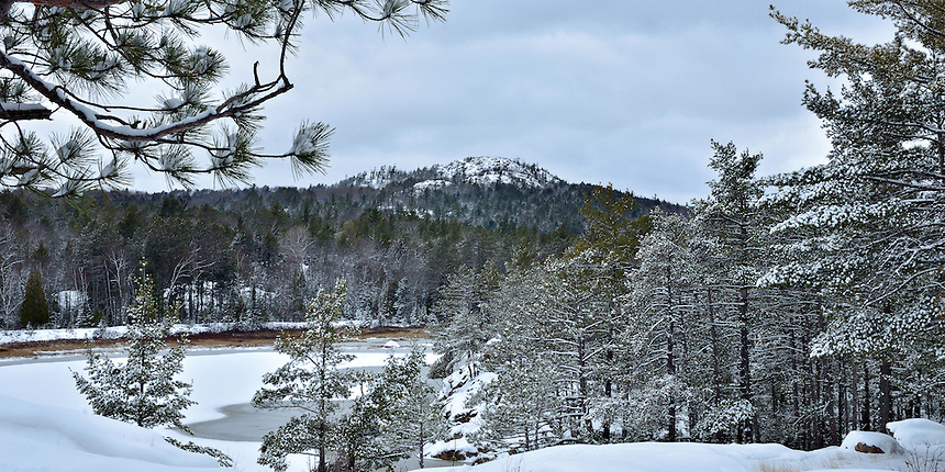 A snowy view of Hogback Mountain and Wetmore Pond. Marquette, MI