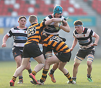 2015 ULSTER SCHOOLS CUP FINAL | Tuesday 17th March 2015<br /> <br /> Patrick Ferguson is tackled by Callum McLaughlin and Ben McGavock during the 2015 Ulster Schools Cup Final between RBAI and Wallace High School at the Kingspan Stadium, Ravenhill Park, Belfast, Count Down, Northern Ireland.<br /> <br /> Picture credit: John Dickson / DICKSONDIGITAL