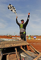 Apr 17, 2010; Surprise, AZ USA; LOORRS pro 4 unlimited driver Rick Huseman celebrates after winning his race during round 3 at Speedworld Off Road Park. Mandatory Credit: Mark J. Rebilas-US PRESSWIRE.
