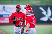 AZL Angels starting pitcher Jose Suarez (96) talks to catcher Erven Roper (97) after warming up in the bullpen prior to the game against the AZL White Sox on August 14, 2017 at Diablo Stadium in Tempe, Arizona. AZL Angels defeated the AZL White Sox 3-2. (Zachary Lucy/Four Seam Images)