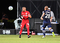 LAKE BUENA VISTA, FL - JULY 26: Auro of Toronto FC heads the ball back during a game between New York City FC and Toronto FC at ESPN Wide World of Sports on July 26, 2020 in Lake Buena Vista, Florida.