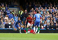 Pictured: Ki Sung Yueng runs at Chelsea defender Ashley Cole <br /> Barclays Premier League, Chelsea FC (blue) V Swansea City,<br /> 28/04/13