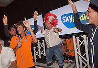 14-sept.-2013,Netherlands, Groningen,  Martini Plaza, Tennis, DavisCup Netherlands-Austria, ,  Dutch Team celebration with students , Austrian fan is posted on stage between Dutch team<br /> Photo: Henk Koster