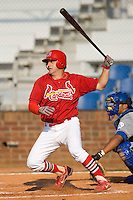 Richard Racobaldo #11 of the Johnson City Cardinals follows through on his swing versus the Burlington Royals at Howard Johnson Stadium June 27, 2009 in Johnson City, Tennessee. (Photo by Brian Westerholt / Four Seam Images)