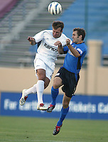 Rapids Defender Ritchie Kotschaus battles the ball in the air against Earthquakes Midfielder Brian Mullan during the first half of the game against Earthquakes at San Jose Spartan Stadium in San Jose, California on July 12th, 2003.  Rapids defeats Earthquakes, final score is 2-0.