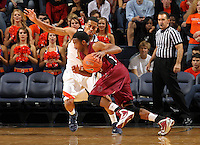 Nov 6, 2010; Charlottesville, VA, USA; Roanoke College g Melvin Felix (12) drives past Virginia Cavaliers g Mustapha Farrakhan (2) Saturday afternoon in exhibition action at John Paul Jones Arena. The Virginia men's basketball team recorded an 82-50 victory over Roanoke College.