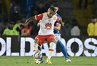 BOGOTA - COLOMBIA -16 -07-2017: Matias D Los Santos (Der) jugador de Millonarios disputa el balón con Wilson Morelo (Izq) jugador de Independiente Santa Fe durante partido partido por la fecha 2 de la Liga Aguila II 2017jugado en el estadio Nemesio Camacho El Campin de la ciudad de Bogota. / Matias D Los Santos (R) player of Millonarios fights for the ball with Wilson Morelo (L) player of Independiente Santa Fe during match for the date 2 of the Liga Aguila II 2017played at the Nemesio Camacho El Campin Stadium in Bogota city. Photo: VizzorImage / Gabriel Aponte / Staff.