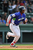 Left fielder Kyri Washington (21) of the Greenville Drive runs toward first base in a game against the Asheville Tourists on Sunday, April 10, 2016, at Fluor Field at the West End in Greenville, South Carolina. Greenville won 7-4. (Tom Priddy/Four Seam Images)