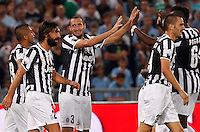Calcio, Supercoppa di Lega: Juventus vs Lazio. Roma, stadio Olimpico, 18 agosto 2013<br /> Juventus defender Giorgio Chiellini, third from left, celebrates with teammates during the Italian League Supercup football final match between Juventus and Lazio, at Rome's Olympic stadium,  18 August 2013.<br /> UPDATE IMAGES PRESS/Riccardo De Luca