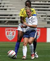 Kristine Lilly v Katia.US Women's National Team vs Brazil at Legion Field in Birmingham, Alabama.