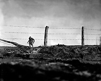 Infantryman goes out on a one-man sortie, covered by a buddy in the background.  82nd Airborne Division, Bra, Belgium. December 24, 1944. Edgren. (Army)<br /> NARA FILE #:  111-SC-197861<br /> WAR & CONFLICT BOOK #:  1073