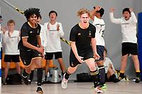 Cooper Duggan of Wellington College celebrates with team mates during the NZ Secondary Schools Senior Boys Final between Wellington College and Tauranga Boys' College at ASB Sports Centre, Wellington on 26 March 2021.<br /> Copyright photo: Masanori Udagawa /  www.photosport.nz