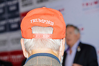 A man wears a Trump 2020 Keep America Great hat while people gather for a Trump campaign office opening party in Salem, New Hampshire, on Fri., Sept. 18, 2020. Former 2016 Trump campaign manager and current 2020 Trump campaign senior advisor Corey Lewandowski, lives in nearby Windham, NH, spoke at the event, which also doubled as a surprise birthday celebration for Lewandowski.