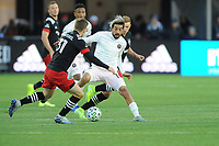 WASHINGTON, DC - MARCH 07: Rodolfo Pizarro #10 of Inter Miami CF battles the ball with Julian Gressel #31 of D.C. United and Russell Canouse #4 of D.C. United during a game between Inter Miami CF and D.C. United at Audi Field on March 07, 2020 in Washington, DC.