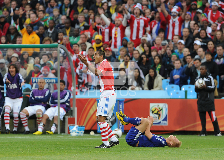 Paulo Da Silva  protests a foul call. Japan and Paraguay played in the second round of the 2010 FIFA World Cup in Loftus Versfeld Stadium, in Pretoria, South Africa, June 29th. After regulation and extra time ended 0-0, Paraguay advanced to the quarterfinals, 5-3, in a penalty-kick shootout.