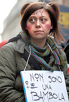 """Manifestazione nazionale contro la violenza maschile sulle donne, a Roma, 22 novembre 2008..A demonstrator holds a sign reading """"I am not a doll"""" during a national rally against male violence on women in Rome, 22 november 2008..UPDATE IMAGES PRESS/Riccardo De Luca"""