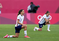 KASHIMA, JAPAN - AUGUST 2: Tobin Heath #7 of the USWNT kneels on the field during a game between Canada and USWNT at Kashima Soccer Stadium on August 2, 2021 in Kashima, Japan.