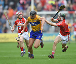 John Conlon of Clare in action against Mark Coleman of Cork during their Munster Senior game at Pairc Ui Chaoimh. Photograph by John Kelly.