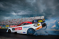 Jul 11, 2020; Clermont, Indiana, USA; NHRA funny car driver Jonnie Lindberg does a burnout during qualifying for the E3 Spark Plugs Nationals at Lucas Oil Raceway. This is the first race back for NHRA since the start of the COVID-19 global pandemic. Mandatory Credit: Mark J. Rebilas-USA TODAY Sports