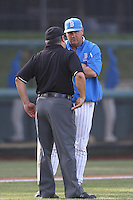 UCLA Bruins Head Coach John Savage listens to the umpires explanation of a play during a game against the Cal Poly Mustangs at Jackie Robinson Stadium on February 22, 2014 in Los Angeles, California. Cal Poly defeated UCLA, 8-0. (Larry Goren/Four Seam Images)