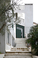 facade of industrial building..In a detached house located in Athens, Greece, built from old construction materials, is located the home and workshop of Armenian Eozen Agopian.