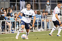 SAN JOSE, CA - AUGUST 13: Brian White #24 of the Vancouver Whitecaps dribbles the ball during a game between San Jose Earthquakes and Vancouver Whitecaps at PayPal Park on August 13, 2021 in San Jose, California.