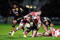 Photo: Richard Lane/Richard Lane Photography. Gloucester Rugby v London Wasps. Aviva Premiership. 02/11/2013 Wasps' Josh Bassett is tackled by Gloucester's Henry Trinder.