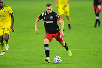 WASHINGTON, DC - OCTOBER 28: Russell Canouse #4 of D.C. United moves the ball during a game between Columbus Crew and D.C. United at Audi Field on October 28, 2020 in Washington, DC.