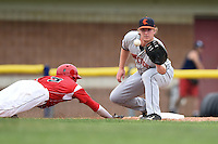 Connecticut Tigers first baseman Jacob Kapstein (18) takes a pickoff attempt throw as Ryan Aper (3) dives back to first during the first game of a doubleheader against the Batavia Muckdogs on July 20, 2014 at Dwyer Stadium in Batavia, New York.  Connecticut defeated Batavia 5-3.  (Mike Janes/Four Seam Images)